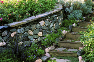 stone retaining wall in the garden in faytteville ar