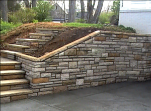 new brick and stone retaining wall and steps in springdale ar
